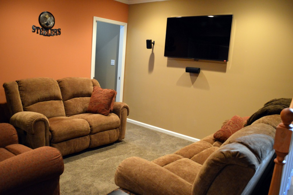 "The seating area has reclining furniture with a 55"" HDTV."
