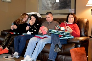 Tara, Megan, Tom and Debbie opening gifts at the party.