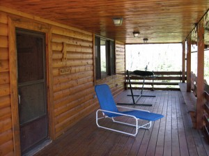 The cabin has an amazing front porch with a hammock.