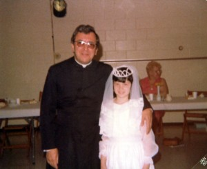 Debbie's First Holy Communion (with Father Lemp), 1980.